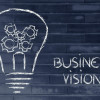 business vision, lightbulb with gearwheels metaphor of success in business