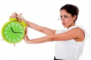 time tracking/woman holding clock/sanespaces.com