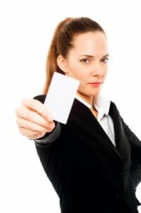 business woman holding out business card/sales/sanespaces.com