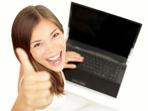 Happy woman with laptop thumbs up/sanespaces.com