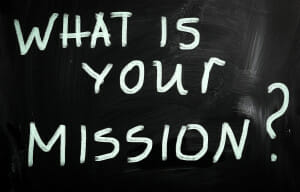 """""""What is your mission """" handwritten with white chalk on a blackb/business mission/business vision/sanespaces.com"""