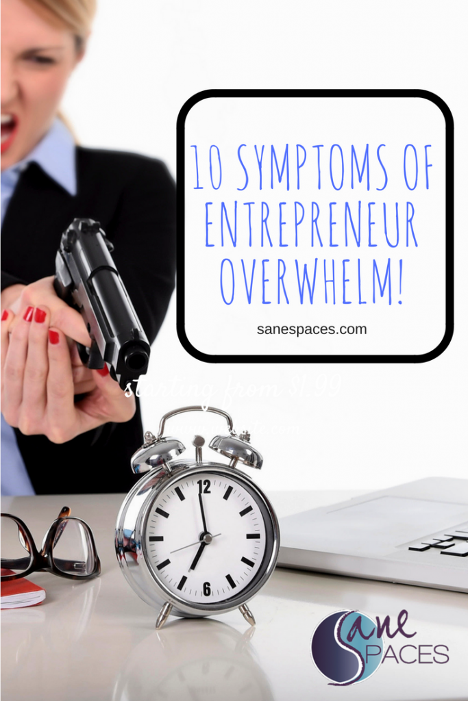 10 Symptoms of Entrepreneur Overwhelm/businesswoman furious and angry pointing gun at computer laptop