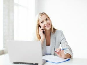 Coaching/hiring a coach/business woman speaking on phone/sanespaces.com