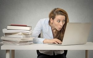 woman looking at laptop with surprise