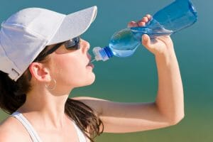 Stay hydrated/Summer sport fit woman drink water bottle